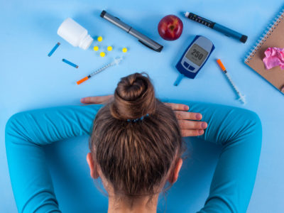 photo of frustrated diabetic woman with head down on table