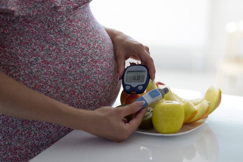 photo of woman with gestational diabetes checking blood sugar level
